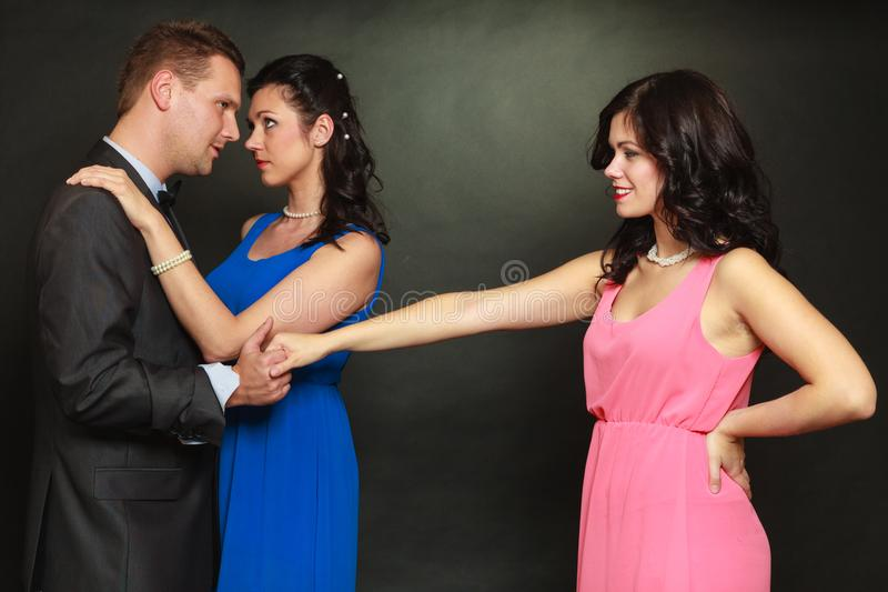 Couple and his jealous woman lover stock photography
