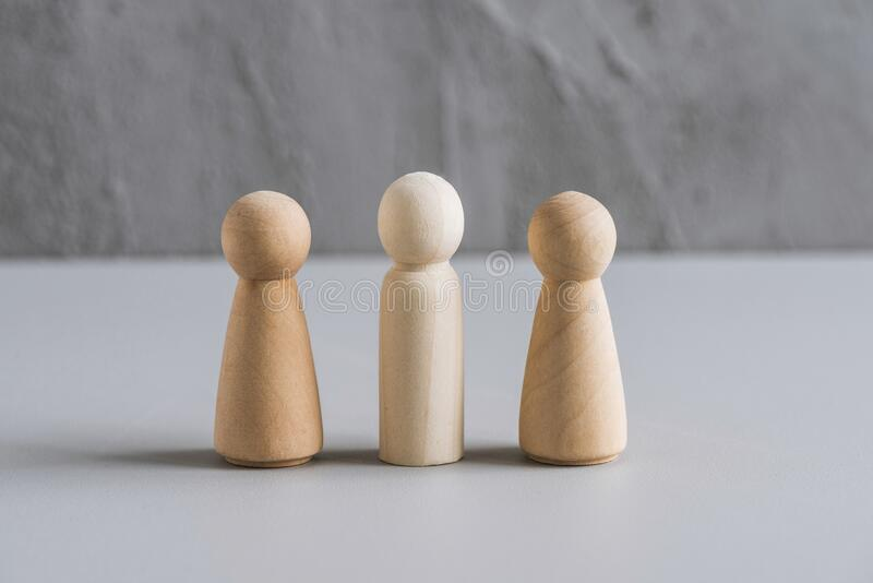 Love triangle concept. One wooden men and two woman. Divorce. Treason. royalty free stock image