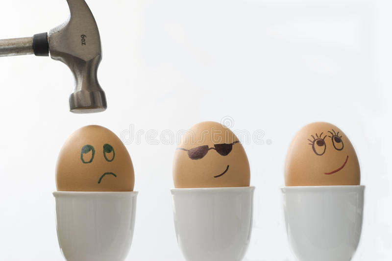 Love Triangle : couple love happiness relationship problems concept, smiley faces drawn on boiled eggs. Love Triangle : two eggs in love the other being attacked royalty free stock photos
