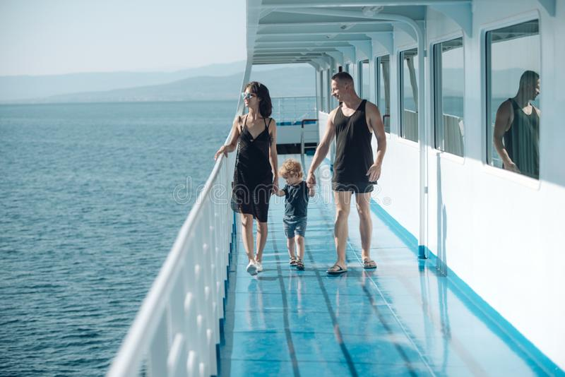 Love and trust as family values. Child with father and mother. Mother and father with son in sea trip. Family ship. Travel with kid on mothers or fathers day royalty free stock photos