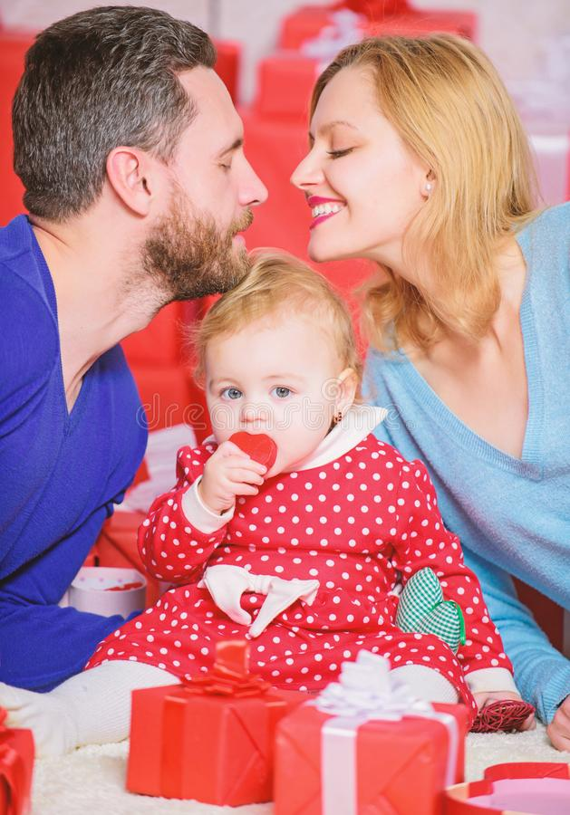 Love and trust in family. Bearded man and woman with little girl. Valentines day. Day to celebrate their love. Shopping. Love and trust in family. Bearded men royalty free stock photo