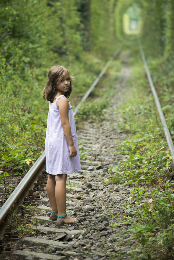 Love tunnel Romania. A small girl on the tracks of the Love tunnel near Caransebes, Romania stock photo