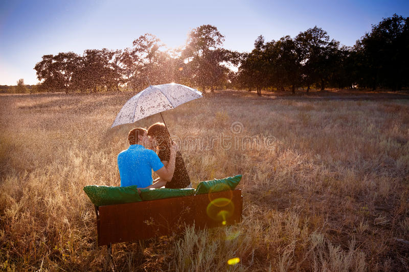Love under the rain. True love under the rain stock photo