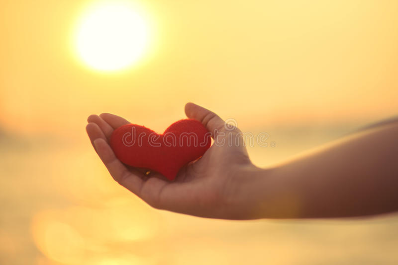 Love for Valentine's day - Two red hearts hung on the rope together with sunset. Love for Valentine's day - red hearts hung on the rope together with sunset royalty free stock image