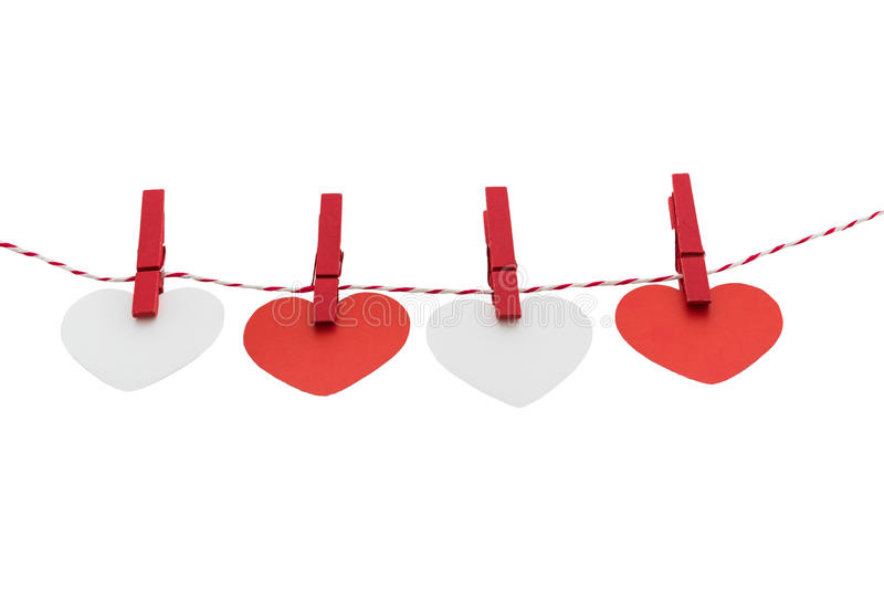 Love Valentine's hearts natural cord and red clips hanging. Love Valentine's hearts and card natural cord and red clips hanging on white background, copy space stock images
