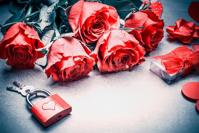 Love and Valentines day concept. Close up of lovely red roses , gift, lock and keys, place for text. Layout for dating , greeting. Card, anniversary and royalty free stock photo