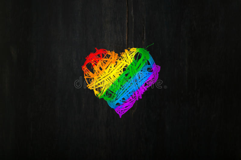 Love Valentines heart wreath in rainbow pride colours dark background royalty free stock images