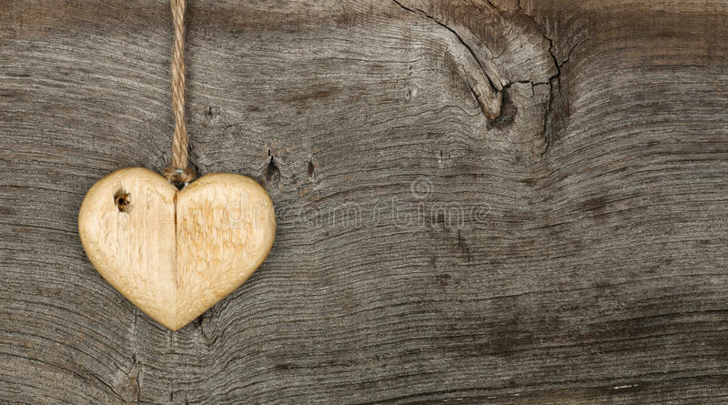 Love Valentines message wooden heart sign on rough grey background stock photo