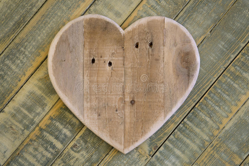 Love Valentines wooden heart on light green painted background royalty free stock image