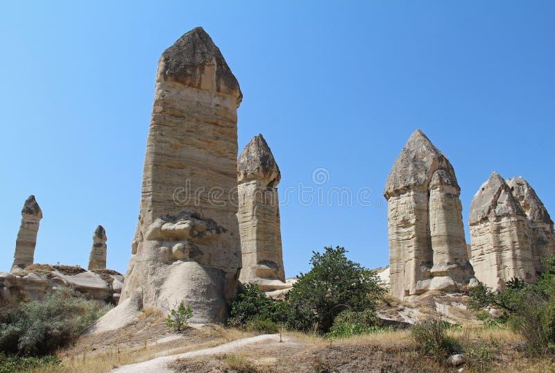 Love valley in Goreme village, Turkey. Rural Cappadocia landscape. Stone houses in Goreme, Cappadocia. royalty free stock images