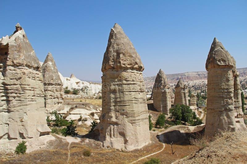 Love valley in Goreme village, Turkey. Rural Cappadocia landscape. Stone houses in Goreme, Cappadocia. stock image