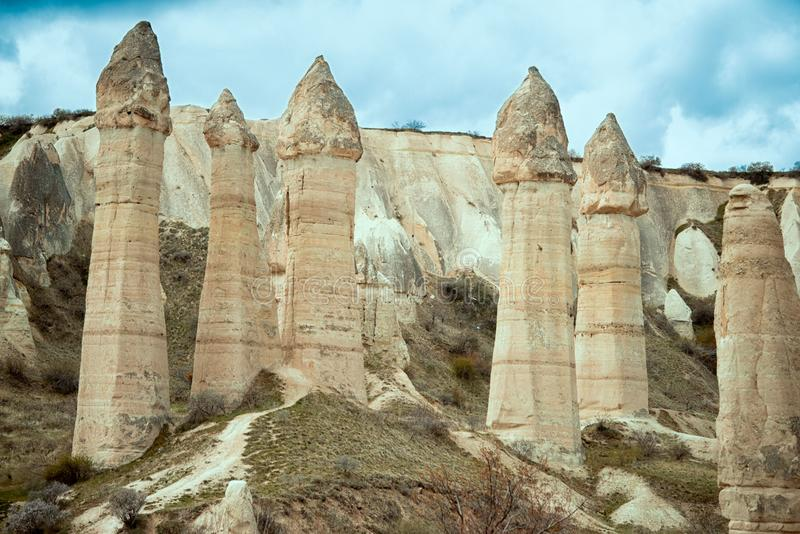 Love valley with huge phallus shape stones in Goreme village, Turkey. Rural Cappadocia landscape. Volcanic tuff mountains in Goreme national park. Countryside royalty free stock images