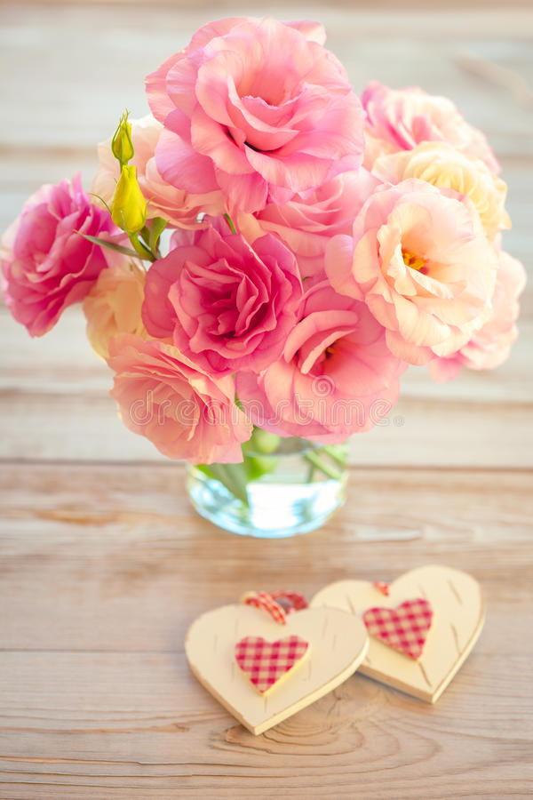 Love Vintage Background - Beautiful Flowers and Two Handmade Hearts royalty free stock photo