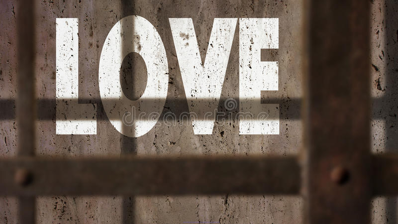 Love On A Wall With Jail Bars Shadow. Love Written On A Wall With Jail Bars Shadow royalty free stock image