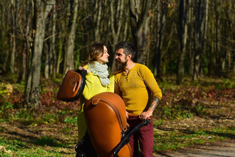 They love weekends. Couple in love walk in autumn park outdoor. Happy family members with baby stroller.  royalty free stock image
