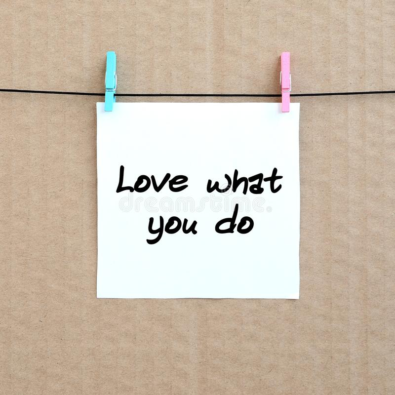 Love what you do. Note is written on a white sticker that hangs royalty free stock photography