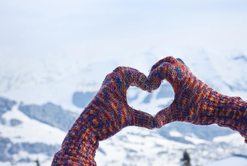 Love winter. Heart from hands in warm cozy gloves stock photo