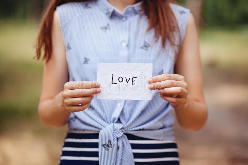Love - woman and card with word , valentines day or religion concept royalty free stock photos
