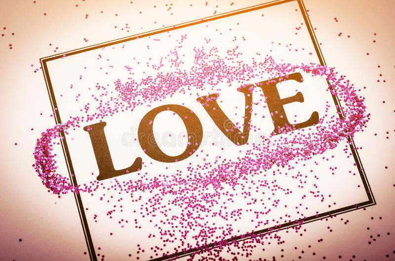 LOVE word with glitter in frame . LOVE word with glitter in frame on beautiful paper background, Valentine`s day concept stock photos