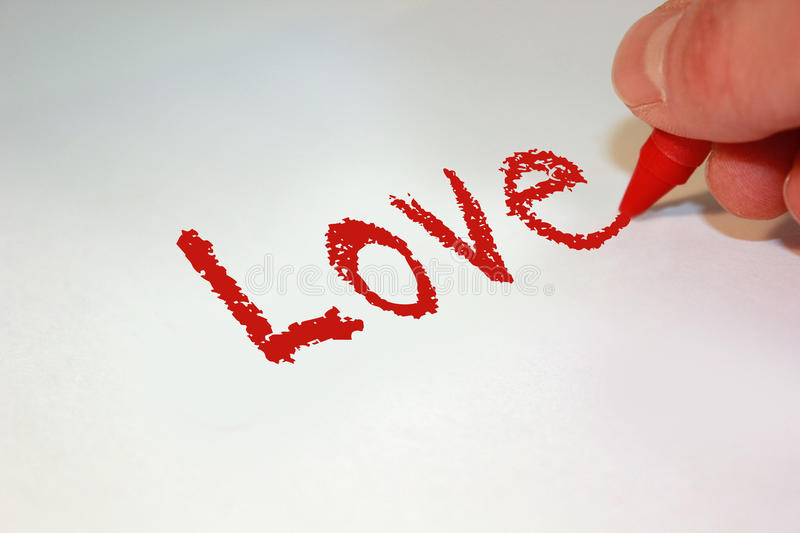 Love. The word love handwritten in red crayon stock images