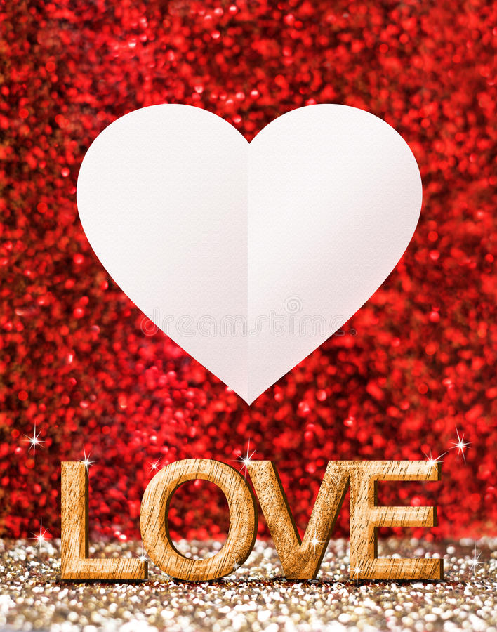 Love word made from wood and white heart in gold and red spar royalty free illustration