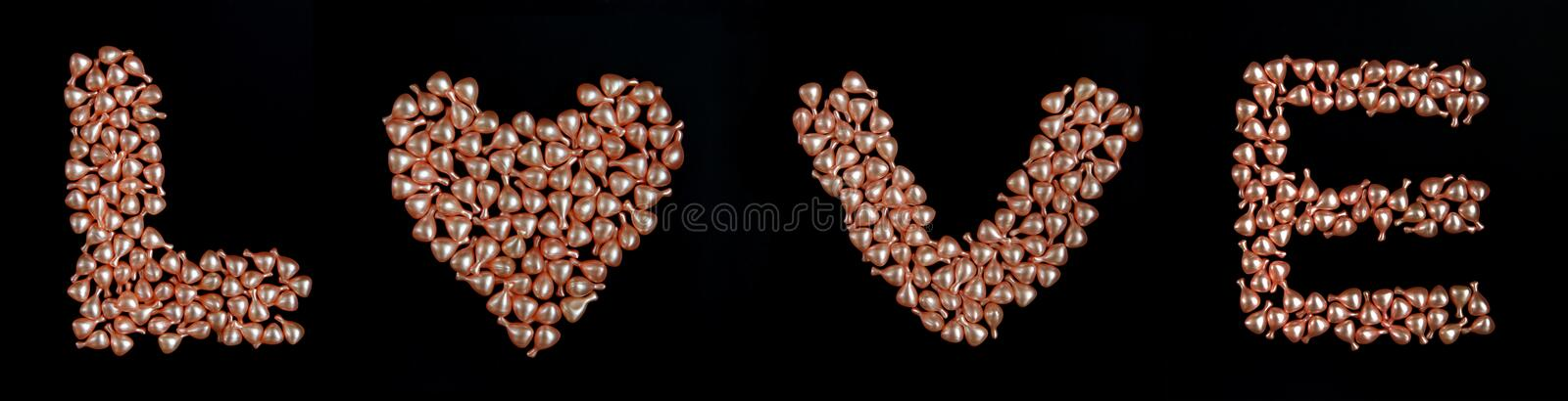 Love word with pearl royalty free stock images