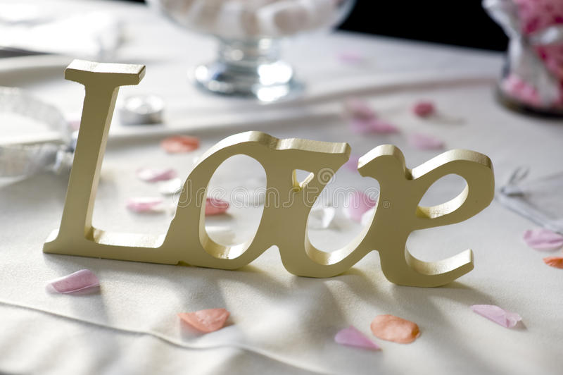 Love word at a wedding royalty free stock image