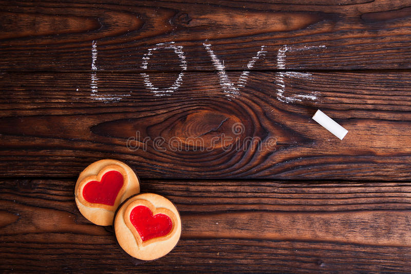 Love word written with chalk and cookies stock image
