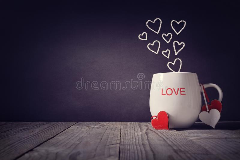 Love written on a mug concept for Valentines day or Mothers day stock photos