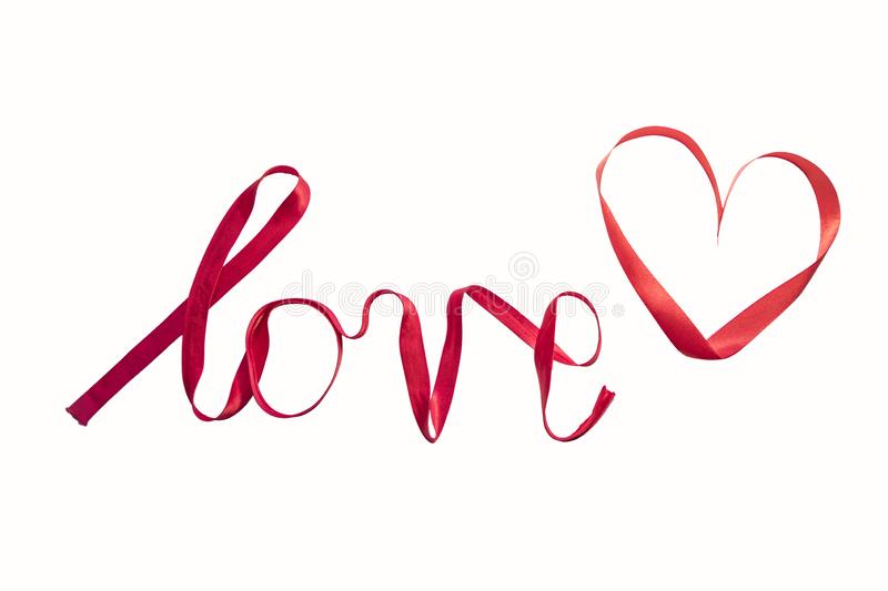 `love` written with red silk ribbon stock photo