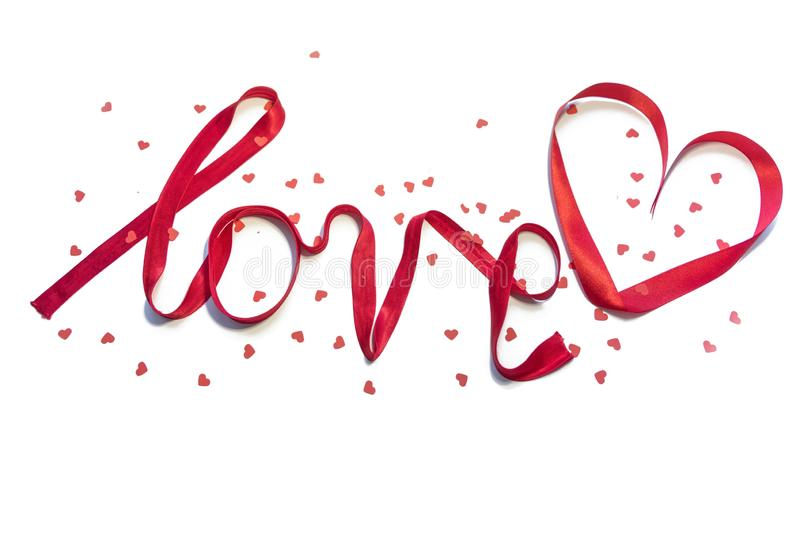 `love` written with red silk ribbon stock photography