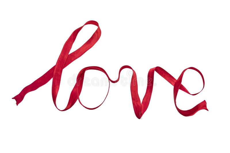 `love` written with red silk ribbon royalty free stock photography