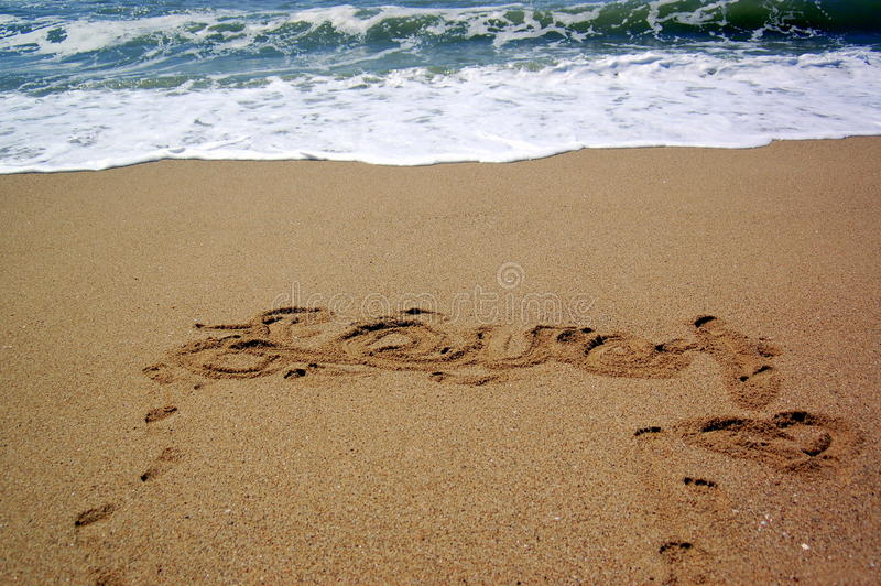 Love written in the sand stock image