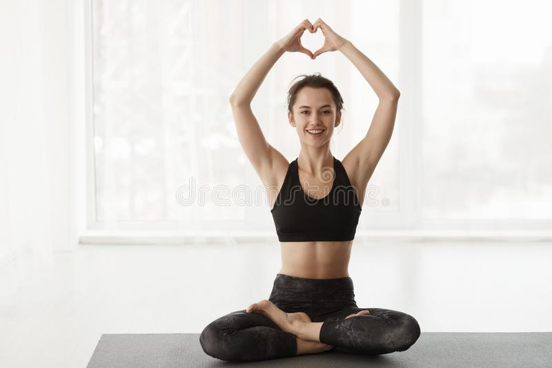 Love Yoga. Woman In Lotus Position Over Window. Love Yoga. Woman In Lotus Position, Holding Hands In Heart Shape Over Window royalty free stock photography