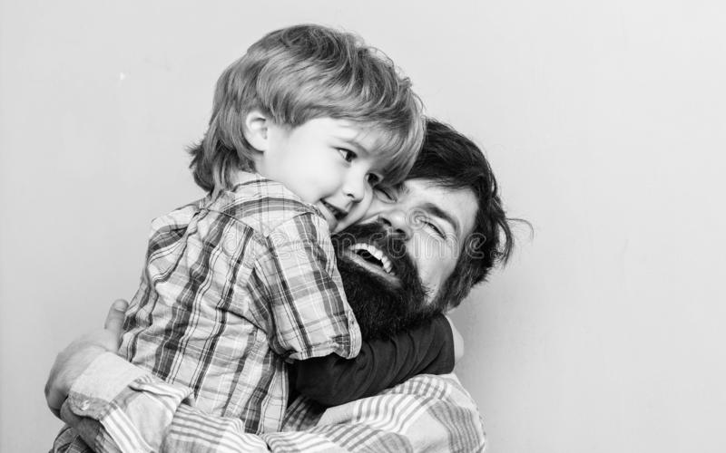 Love you dad. father and son embrace. happy family leisure. small boy hug dad. love to be together. child development royalty free stock images