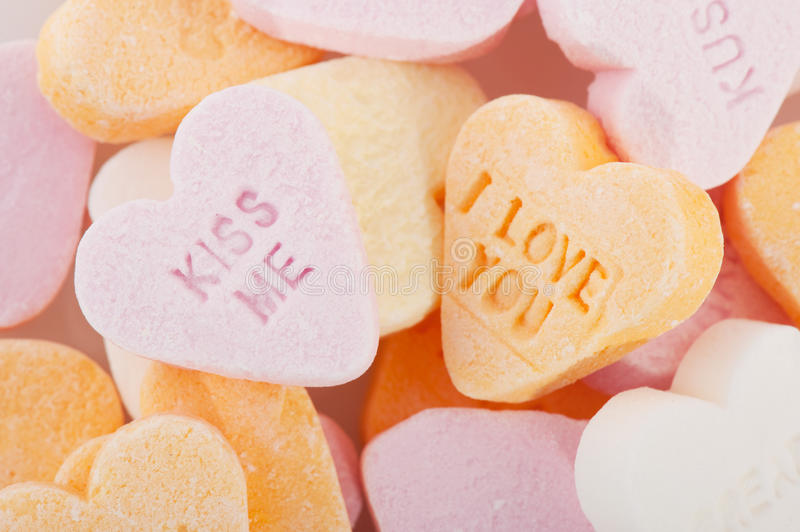 Love you and kiss me candy hearts stock photos