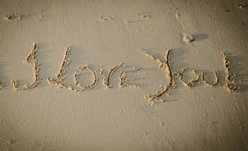 Love You Writing on Sand royalty free stock images