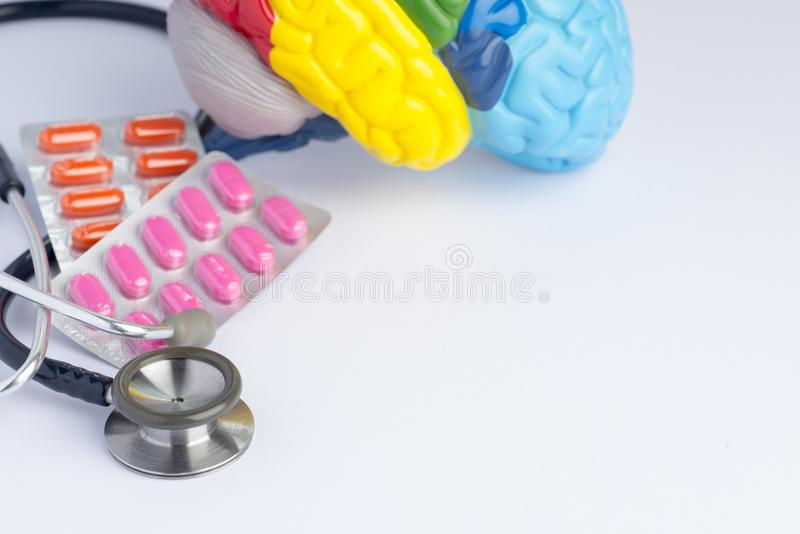 Love your brain/mental health concept-pills in blister pack. Love your brain/mental health concept shot in a studio - stethoscope, a colorful brain model and royalty free stock images