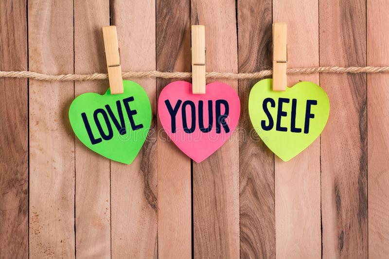 Love your self heart shaped note royalty free stock photography
