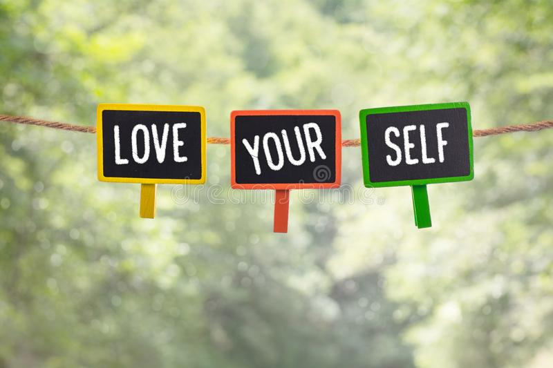 Love yourself on board royalty free stock image