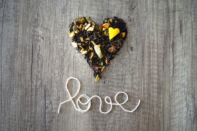 Loved tea. Heart of green, black and fruit tea with small lemon heart. Loved tea stock photos