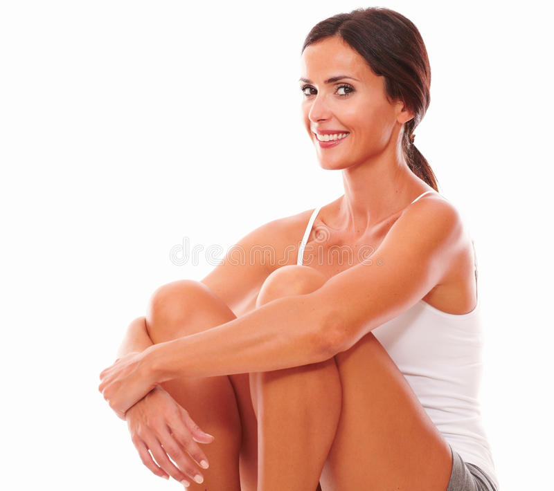 Lovely adult woman baring fair skin. Lovely sporty woman baring fair skin while looking at you on isolated background royalty free stock photos