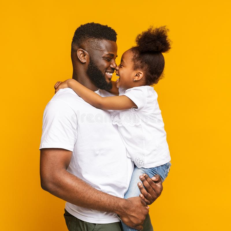 Free Lovely African American Daddy And Daughter Touching Noses And Cuddling Stock Photos - 158637533
