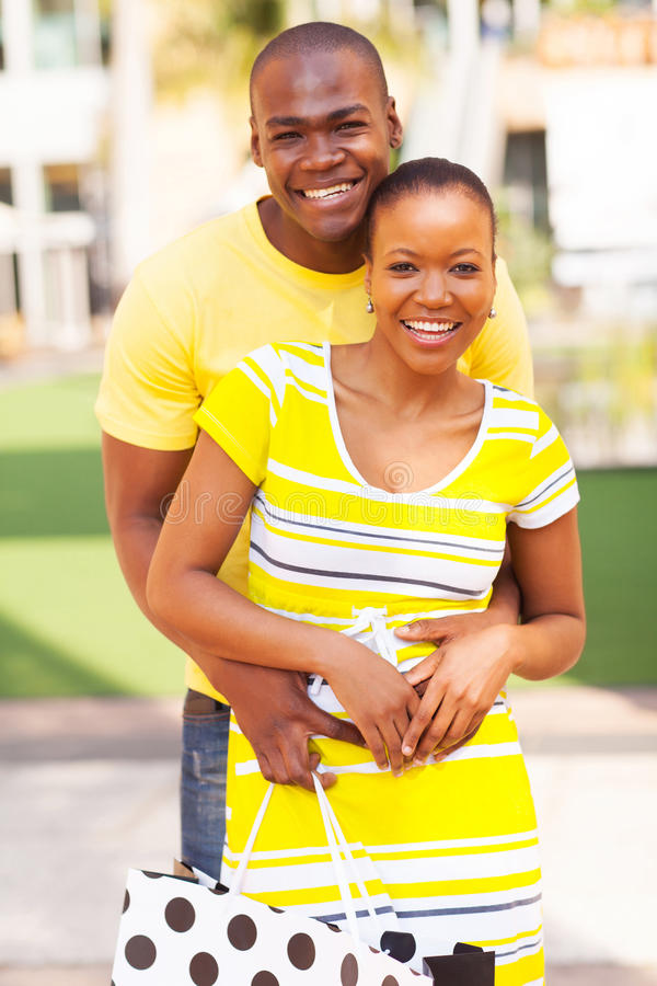 Lovely afro american couple. Portrait of lovely afro american couple with shopping bag royalty free stock photo