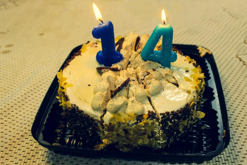 Cake with candles on the birthday table royalty free stock photography