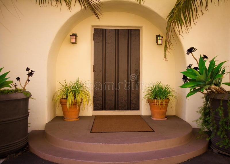 Front Door. Lovely arched front door entry royalty free stock images