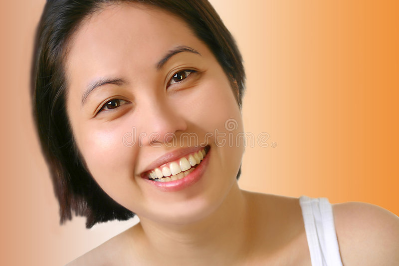 Lovely Asian. Happy and laughing asian beauty. Fit for bright future, dentist, dental care, cosmetic, etc. concept or lay-out stock photos