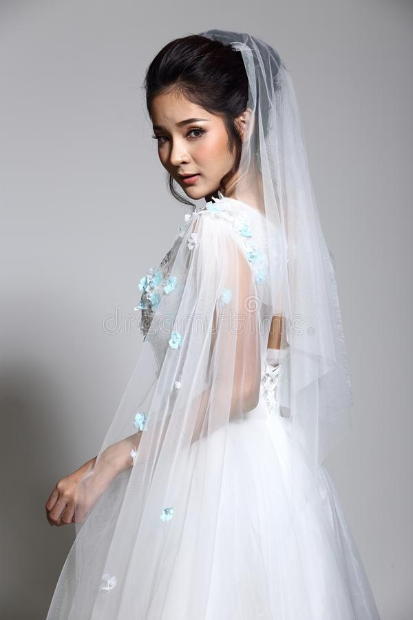 Free Lovely Asian Beautiful Woman Bride In White Wedding Gown Dress W Stock Images - 99465304