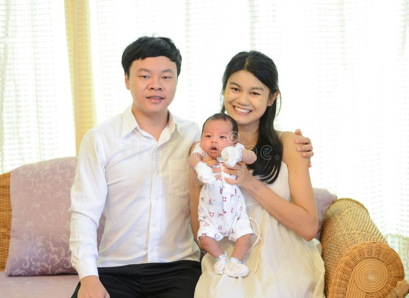 Lovely Asian family holding 1-month-old newborn baby boy on hand, Lovely, royalty free stock photo