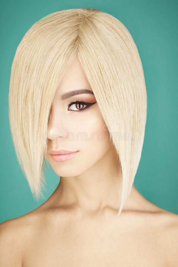 Lovely asian woman with blonde short hair. Fashion studio portrait of lovely asian woman with blonde short hair. Fashion and beauty. Bright makeup. Fashionable stock photos